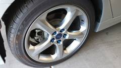 5-Spoke Wheel with Blue lug nuts and valve stem cap